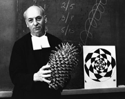Brother Brousseau holds up a large pine cone to demonstrate the Fibonacci principle of mathematics.